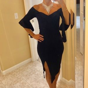 Navy midi dress with flowy sleeves and front slit.